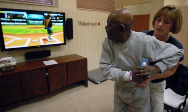 休閒治療師運用音樂和藝術、以及遊戲和運動,使受傷的人康復。(Getty Images)