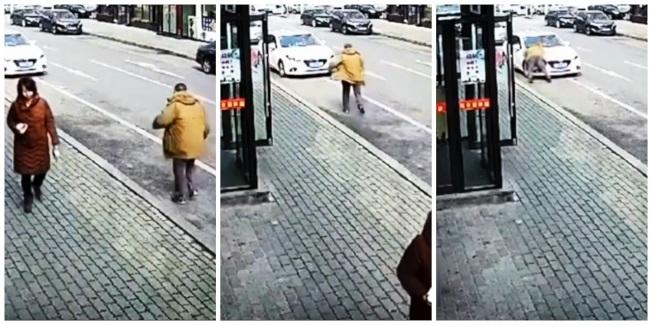 中國遼寧省大連市20日中午發生一位老先生從幾十公尺外「慢跑衝刺」,朝著一輛停在路旁的汽車撲去,隨後跌坐在路面上,駕駛下車理論,挑明「這是活生生的碰瓷」。路透/Newsflare
