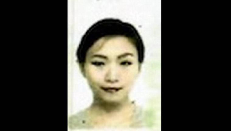 闖入海湖莊園的中國女子張玉婧被控兩項罪名。(圖取自護照)