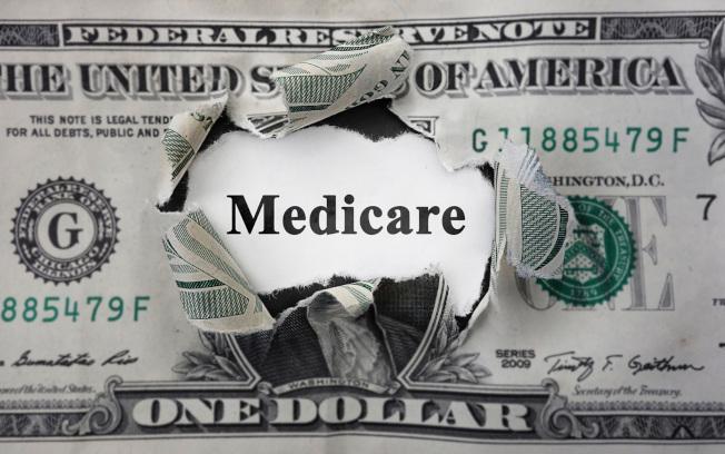 美國健保不但是政府的財政負擔,也是民眾的負擔。(TNS)