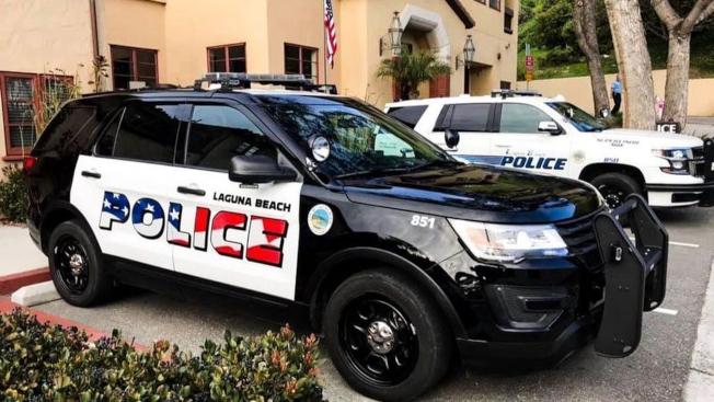 拉古納灘市警車漆上星條旗圖案(前)引起爭議。後方為未變更的警車塗裝。(推特照片)