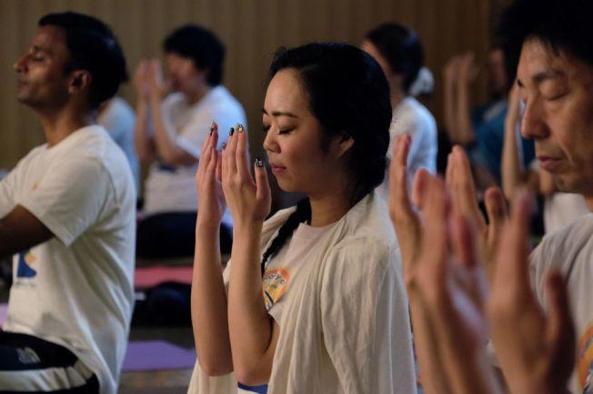 如果想要靜下來冥想,有手機應用程式號稱可以幫忙做到。(Getty Images)