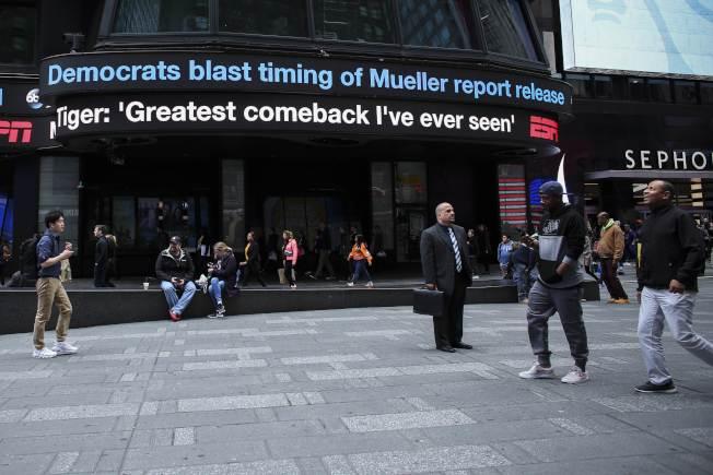 刪節版穆勒報告公布,曼哈頓時報廣場的ABC新聞立即報導民主黨反應。(Getty Images)