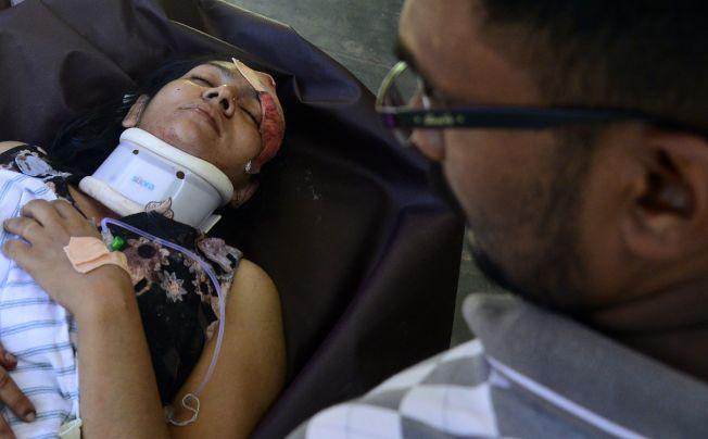 拜蒂克洛地區一座教堂受傷的女子在醫院急救中。( Getty Images)
