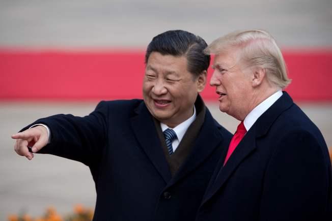 圖為川普總統去年11月訪問北京,會見中國國家主席習近平。(Getty Images)