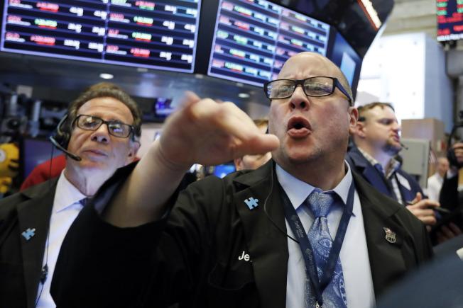 美中貿易衝突可能加劇,美股周三挫跌。 美聯社