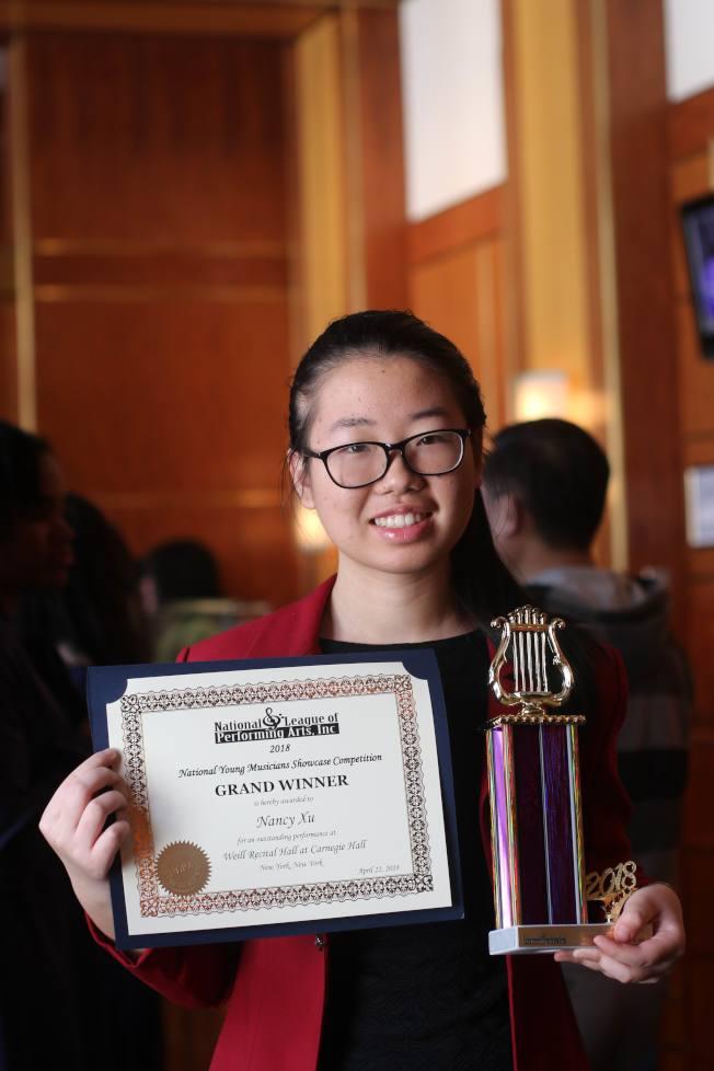 夢想家音樂藝術中心學生Nancy Xu,在2018年參加國際性National League Of Performing Arts Grand Winner項目中,榮獲古箏金獎。(夢想家音樂藝術中心)