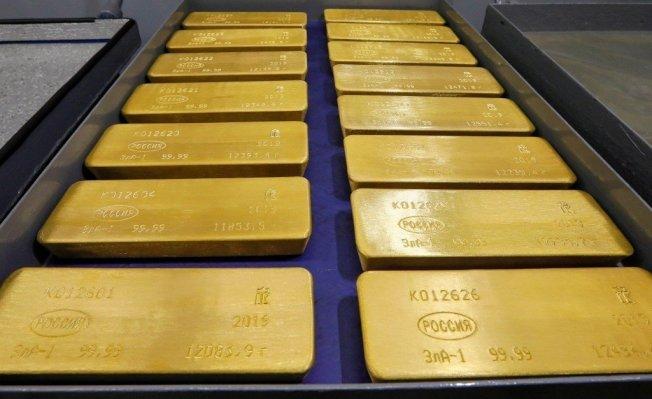 市場擔憂美中貿易戰持續升級,會演變成貨幣戰。台灣銀行貴金屬部副理楊天立表示,如果發生貨幣戰,避險的除了美元之外還有黃金。 路透