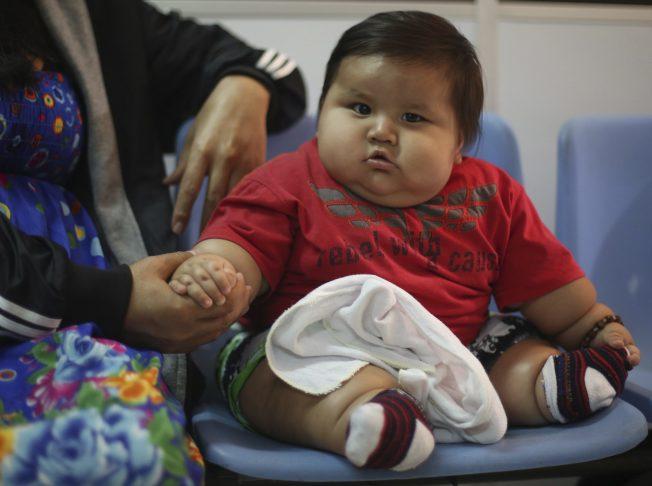 體重曲線在童年初期開始出現差異,若能即早干涉有很高機會有效預防未來肥胖。(路透)