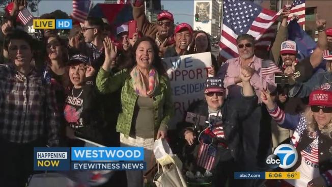 川粉在西木區聯邦大樓外面回嗆要求彈劾川普示威民眾。(ABC7電視台)