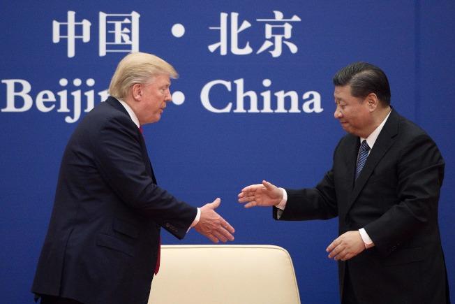 美國總統川普18日表示,他和中國國家主席習近平將在日本出席20國集團(G20)高峰會時將舉行川習會。圖為川普與習近平2017年11月在北京會面。Getty Images