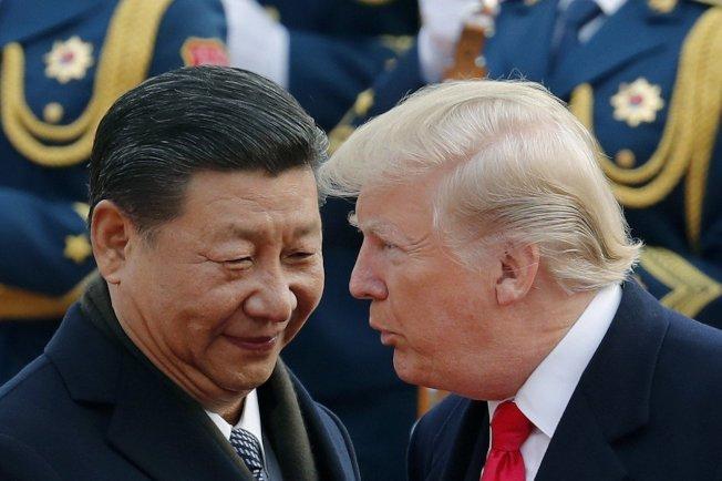 圖為2017年11月川習二人在北京碰頭寒暄。 美聯社資料照片