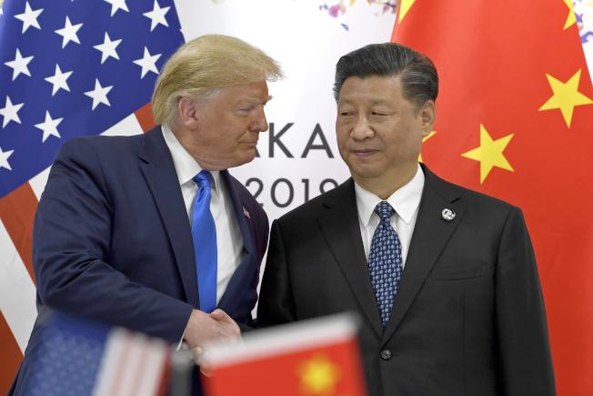 川普總統與習近平主席,29日上午在日本大阪G20峰會上舉行美中峰會,談論美中貿易。(美聯社)