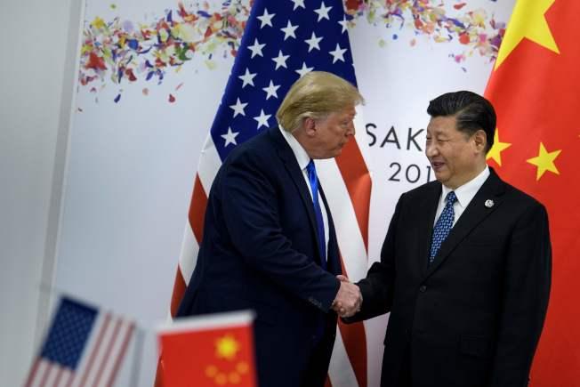 川普表示現在習近平關係不密切了。圖為川習兩人6月底在日本大阪G20峰會上見面。(Getty Images)
