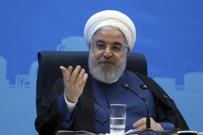 伊朗總統羅哈尼近日表態,如果美國願意取消經濟制裁,伊朗願意重回談判桌。(美聯社)