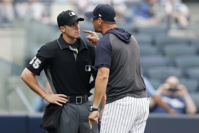 洋基總教練布恩(右)粗口罵人,全被收音。(美聯社)