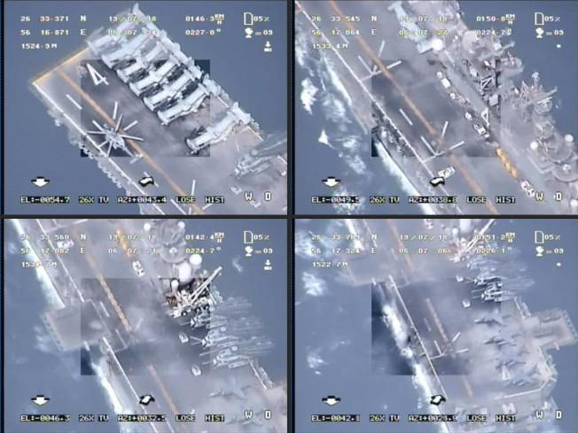 伊朗革命衛隊發布的錄像截圖顯示,伊朗無人機在荷莫茲海峽飛越一艘航母,並攝下影像。伊朗宣稱,所有無人機均安返基地。(Getty Images)