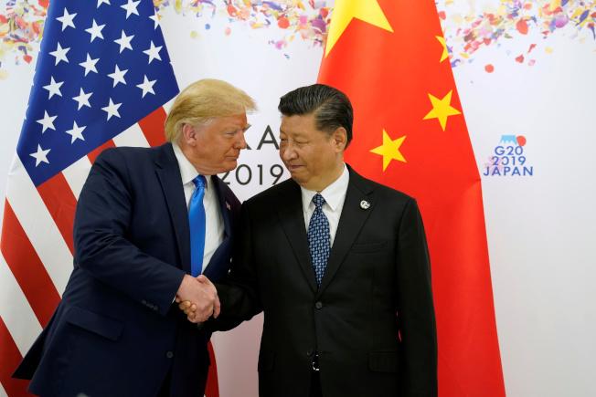 今年6月底在日本大阪G20川習會中,中方承諾會購買美方農產品。(路透)