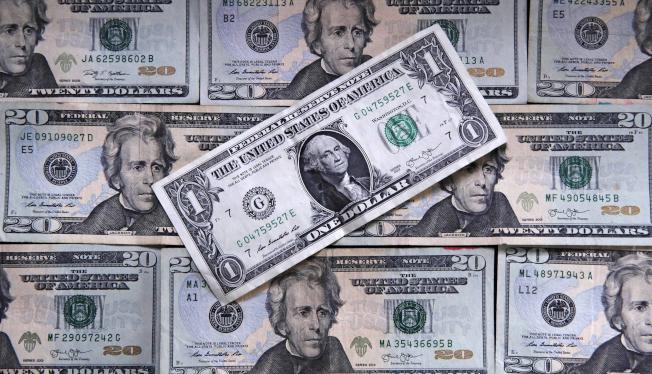 如果在『貨幣冷戰』中要有個勝利者,那一定會是美國,因為美元自此會變得越來越弱,而不是變強。(美聯社)