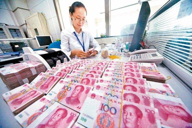 人民幣在岸即期匯價昨天收盤跌破6.88大關,下探兩周低點。(本報系資料庫)