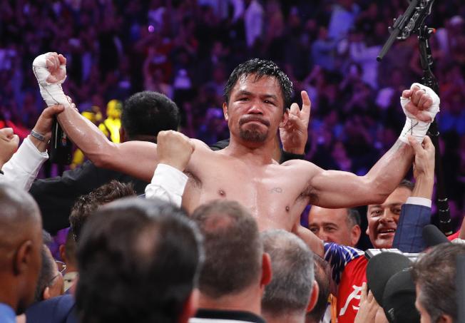 帕奎奧成為拳壇有史以來最年長的次中量級冠軍。(美聯社)