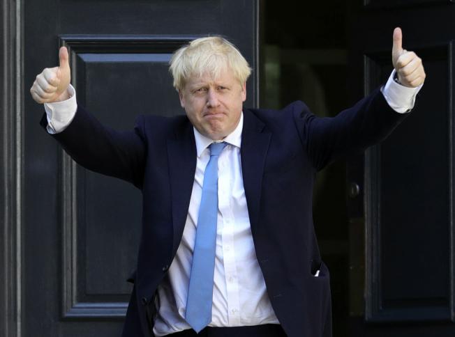 強生接任英國首相。美聯社