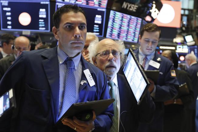 美國股市今(24)日早盤走跌,因波音和卡特彼勒財報不盡理想,打擊投資人信心。美聯社