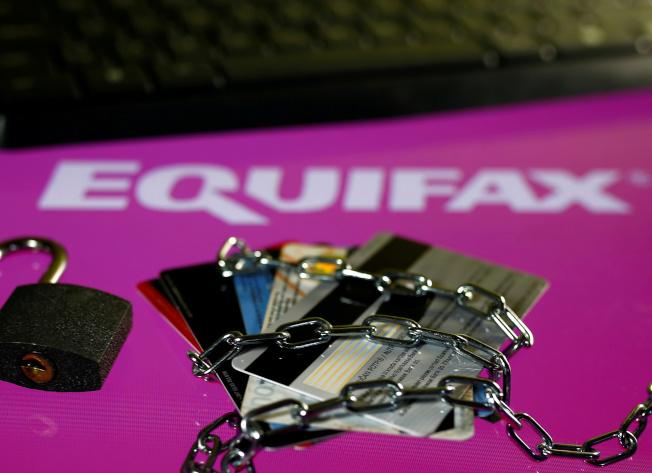 徵信機構Euqifax遭駭後,與多州達成理賠協議,每位受害用戶可獲125元賠償金。但有不法之徒假設網站,再次騙取用戶的個資。(美聯社)