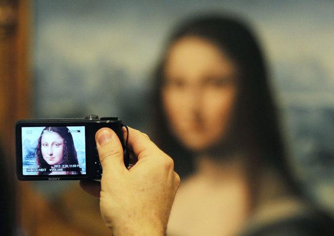 《蒙娜麗莎的微笑》舉世聞名,每年吸引無數遊客。(Getty Images)
