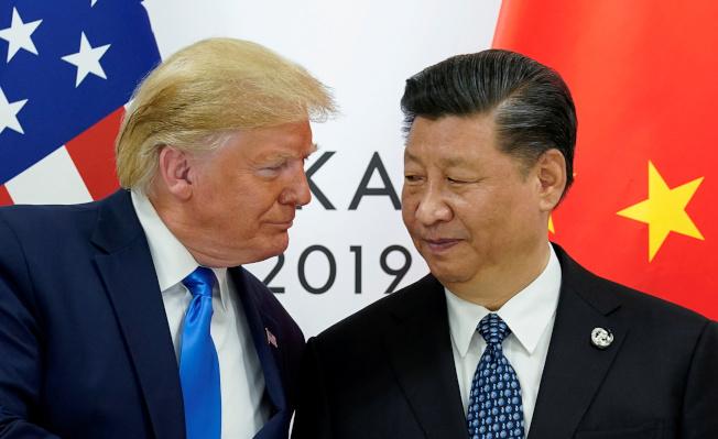 美國川普(左)與中國國家主席習近平今年6月在大阪G20峰會。(路透)