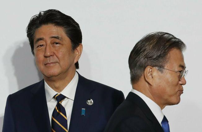 日韓最近起貿易爭端,在政策上拳腳相向。但人民幣若走貶,兩國都將遭殃,同淪美中匯率戰下的受害者。美聯社
