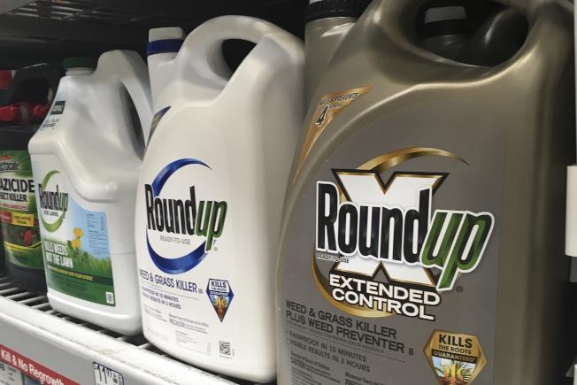 去年收購除草劑Roundup製造商孟山都的拜爾公司,據傳有意以80億元和解。(美聯社)