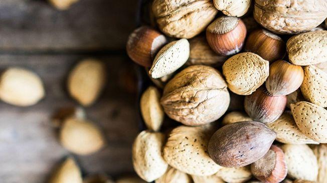 研究發現,每天吃大約60克的堅果可以改善性功能。(ingimage)