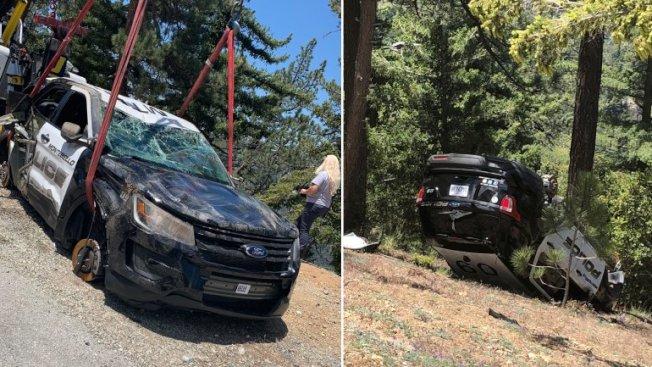 警方吊起慘遭推下山谷的警車。(蒙地貝婁市警局提供)