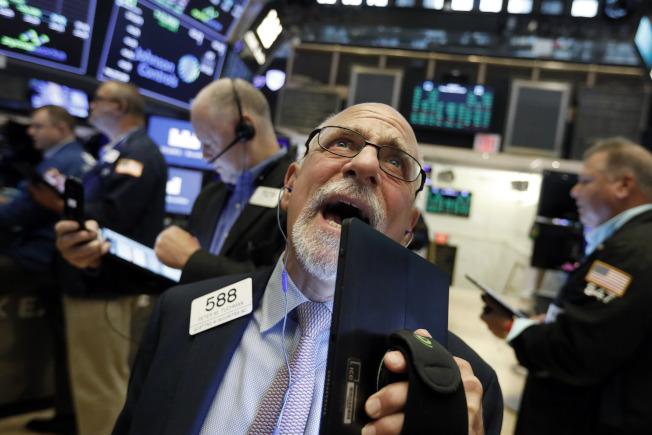 債券殖利率谷底反彈,道指漲306點。(美聯社)
