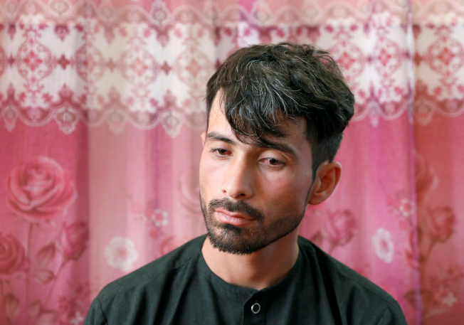 阿富汗爆炸案,倖存新郎阿爾密悲痛失去希望。(路透)
