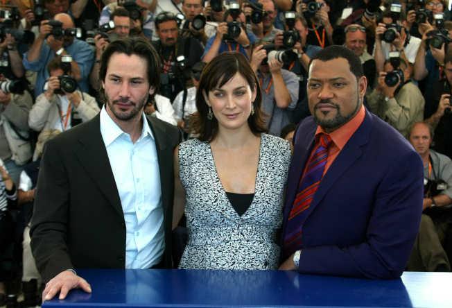 基努李維(左起)和凱莉安摩絲都要參加「駭客任務4」演出,只有勞倫斯費許朋不確定是否回鍋。(路透資料照片)