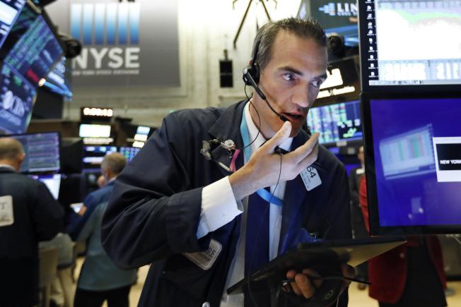 零售商的強勁財報提振投資人情緒,股市21日走升。(美聯社)
