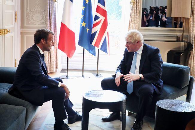 英國新任首相強生22日前往巴黎總統府會見法國總統馬克宏。(Getty Images)