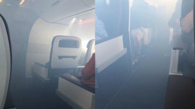 這張不要用,看不清楚  乘客拍到的照片顯示,機艙滿布濃煙。(取自推特)