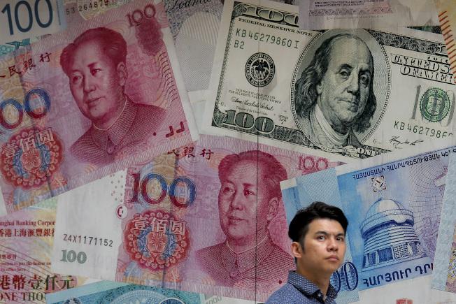 分析師認為人民幣最近的貶勢不會持續太久。美聯社