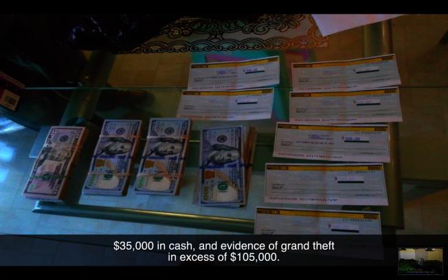 警方收繳贓款。(警方視頻截圖)