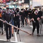 香港前政務官籲警停止過當執法、示威者恢復理性抗議