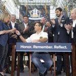 葛謨簽法 追增911救援英雄福利