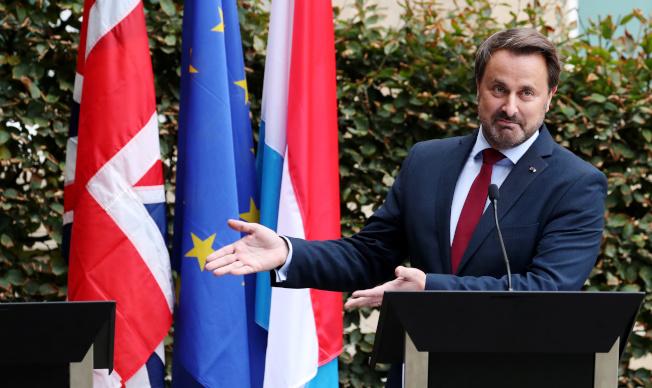 英國首相強生取消與盧森堡總理貝特記者會,遭貝特嘲諷。(路透)