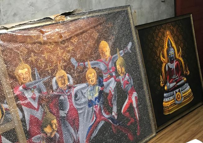 泰國女大學生將佛像身軀變成《超人力霸王》,這種結合動漫特攝的趣味,沒想到卻在泰國引起兩極化的批評。(路透)