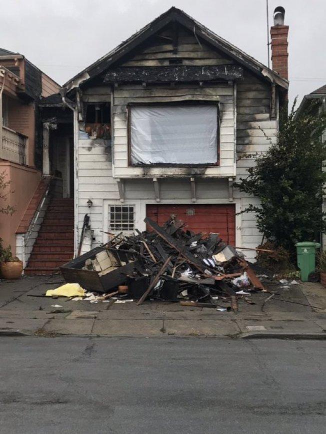 米慎台發生火警的住宅,一對父女被困火海之中,一同喪生。(電視新聞截圖)
