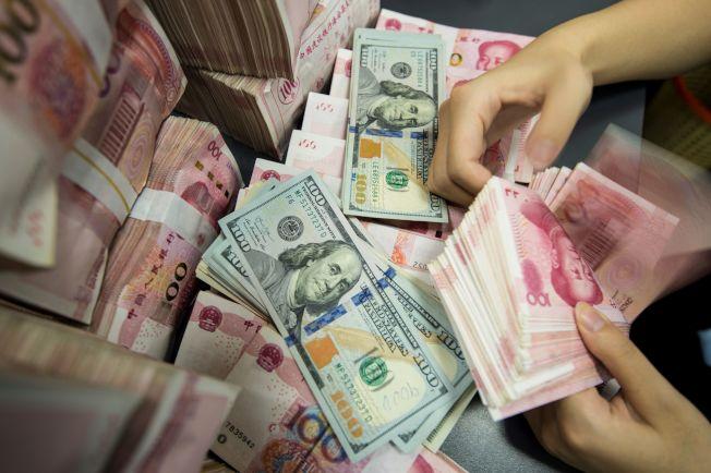 2019年第一季中國企業、家庭和政府債務總額達到占GDP驚人的303%。(Getty Images)