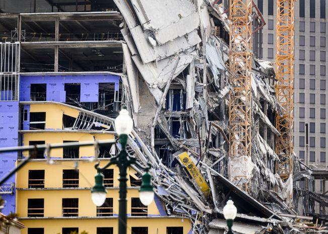 紐奧良市中心一棟興建中飯店大樓,頂端的6至8層12日早上坍塌,造成1死和至少18傷,另有3人失蹤。(Getty Images)