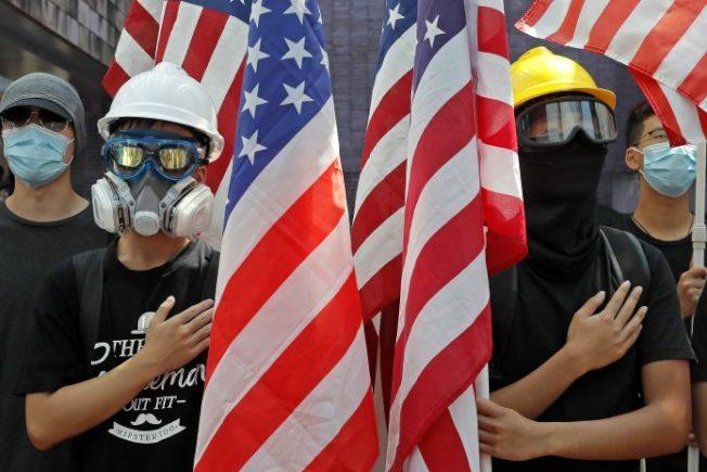 中美貿易戰看似暫時停火,但NBA及香港事件持續發酵,中美關係恐進入「新冷戰」。(美聯社)